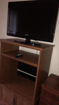 flat screen television with brown wooden TV stand Apple Valley, 55124