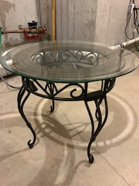 Glass top side table with iron kegs KCMO