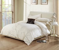 white and gray bed comforter