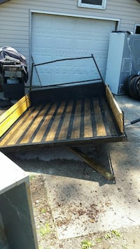 brown and black utility trailer Albion, 16401