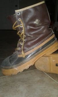 pair of black leather boots 3141 km
