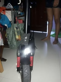 black and red motor scooter