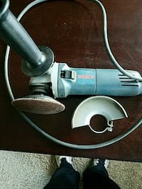 gray and black corded power tool