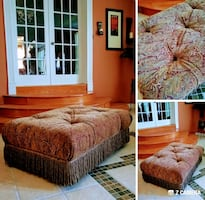 Huge ottoman with wheels. Very nice fabric. In goo
