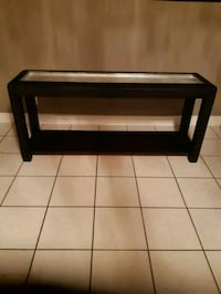 Black and silver glass top console table.  Whitby, L1N 9E2