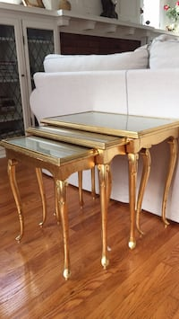 Rectangular gold colour end tables with glass top, they can be pulled apart and used individually or pushed back into one Montréal, H8T 2K9