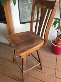 Two Swivel solid wood chair.
