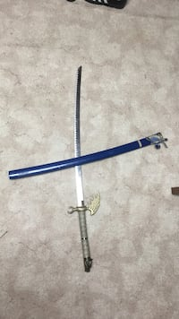 gray-handled stainless steel katana with blue scabbard