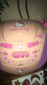 White and pink hello kitty digital device