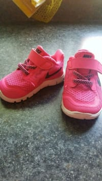 pair of pink Nike running shoes Kitchener, N2M 2C6