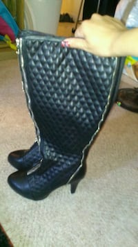 pair of black leather boots Halifax, B3J 1S5