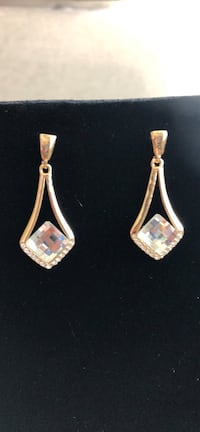 pair of women's silver-colored dangle earrings with clear gemstones Arlington, 22202