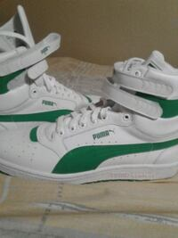 pair of white-and-green Puma sneakers St. Catharines, L2P
