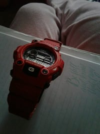 red and black digital watch 68 km