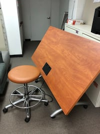 brown wooden table with stainless steel base Woodbridge, 22191