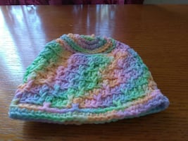 green, purple, and peach crochet knit cap