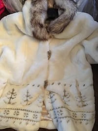 white and brown fur-line coat