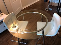round clear glass top table with white metal base Toronto, M2K