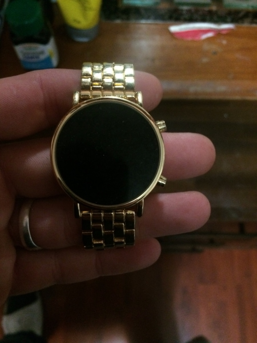 round gold digital watch with gold links - New Westminster