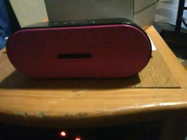 Pink and black Bluetooth speaker