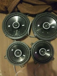 four black-and-gray coaxial speakers
