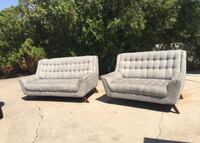 Two gray tufted futons