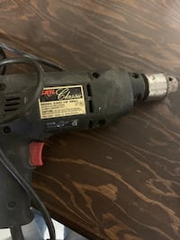 Gray and black corded power drill.