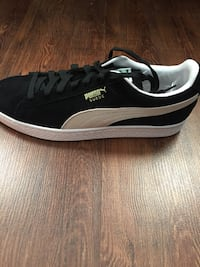 black-and-white Puma low-top sneakers