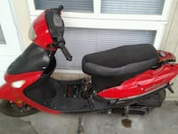 Red and black moped Hillcrest Heights, 20745