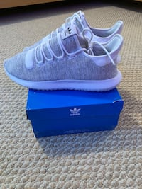 Pair of white-and-blue adidas sneakers Springfield, 22150