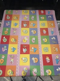 baby's pink, blue, yellow, red, orange, and green playmat