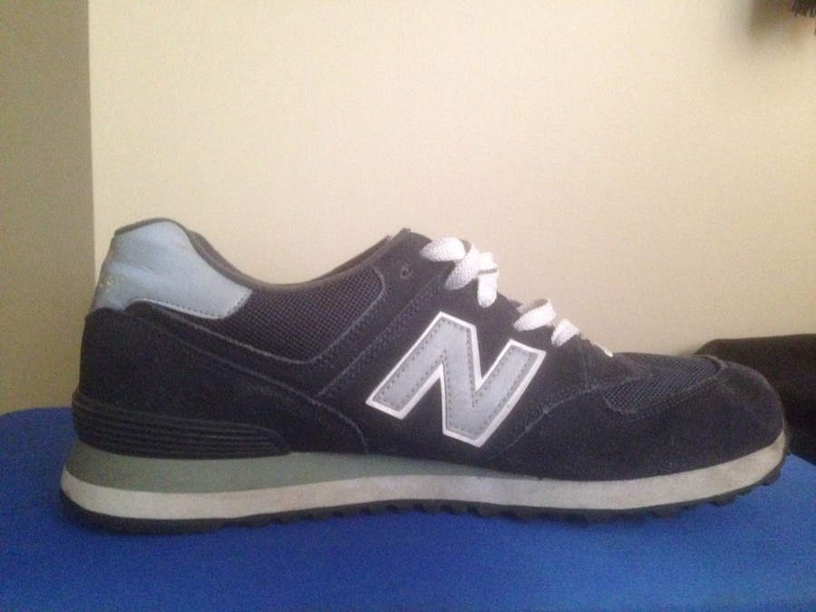 gray and black New Balance low top sneakers - Ontario