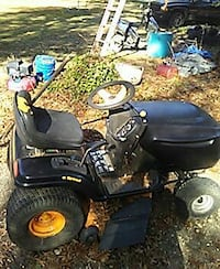 black and grey riding mower