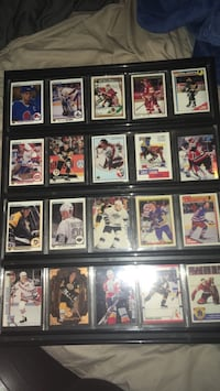 assorted hockey trading cards with black wooden frames