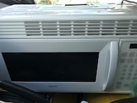 white General Electric microwave oven Valrico, 33596