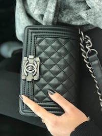 quilted black Chanel leather chained crossbody bag