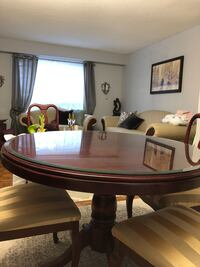 oval brown wooden table with four chairs dining set Toronto, M1T 1V7