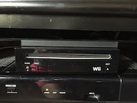 Wii game console, 3 remotes and 5 games Woodbridge, 22193