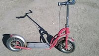 red and black kick scooter