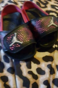 pair of black-and-red Nike basketball shoes Utica, 13501