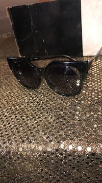 black framed Ray-Ban sunglasses Toronto, M4E 1R4