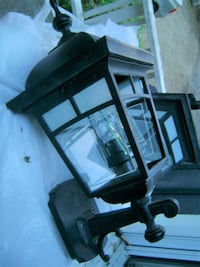 Two large complimenting outdoor lamps. One is upside, the other downsided. SECHELT