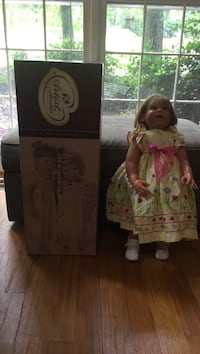 porcelain doll with box