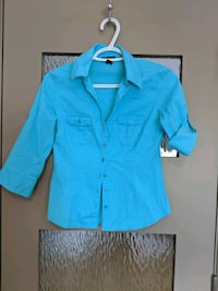 Blue blouse with spandex size small Calgary, T2E 0B4