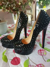 Louboutin spiked shoes  553 km