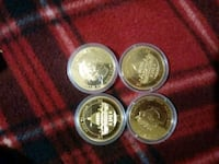 four round silver and gold coins Clarksville, 47129
