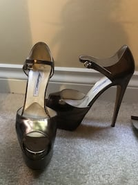 pair of brown leather ankle strap heeled sandals North Vancouver, V7N 1M1