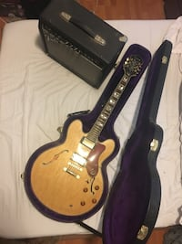 Blonde epiphone hollow body electric guitar with fender amp
