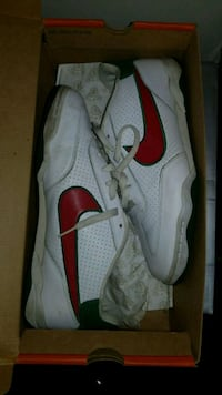 pair of white-and-red Nike basketball shoes 28 mi