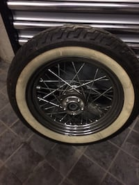 Gray multi-spoke motorcycle wheel with white wall tire Laval, H7E 5H7